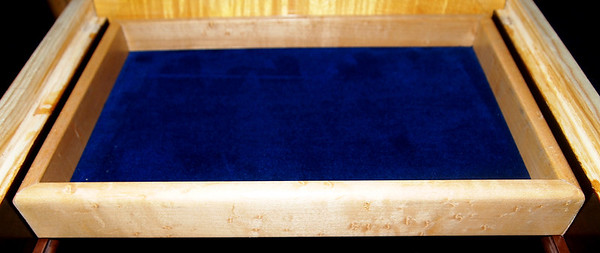"To make it extra comfy, the bottom is blue velvet.  It is wrapped around 1/8"" ply and secured with hide glue on the edges."